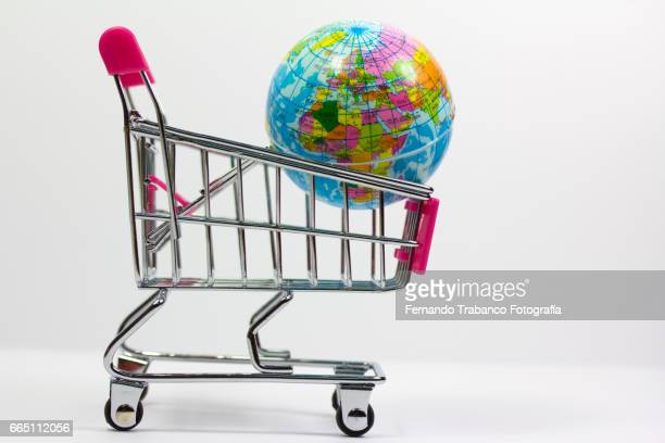 Shopping cart with a globe. Vacation and travel