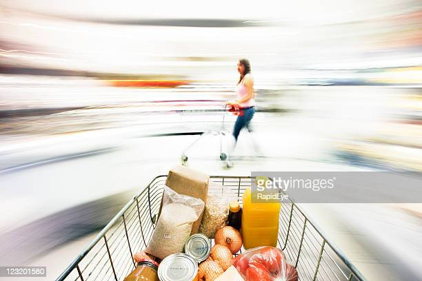 Shopping cart with extreme motion blur in supermarket