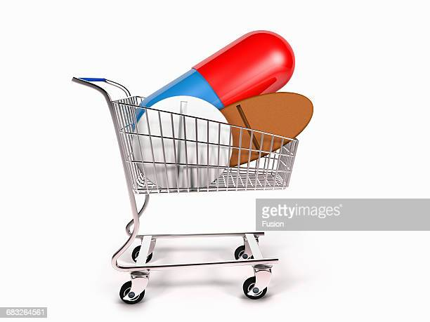 Shopping Cart With Giant Pills Inside