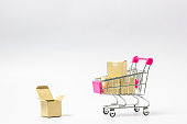 Online market place, eCommerce concept : Shopping cart with paper carton ready to shop on white background Ordered by customer through the media via internet show that trading is quick and easy.