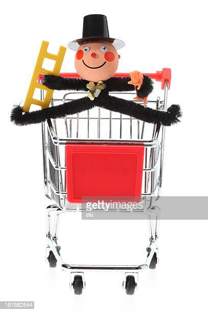 Shopping cart with toy chimney sweeper on front