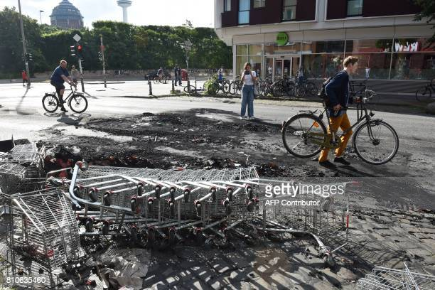 Shopping carts lay in the street after riots in Hamburg's Schanzenviertel district on July 8 2017 in Hamburg northern Germany where leaders of the...