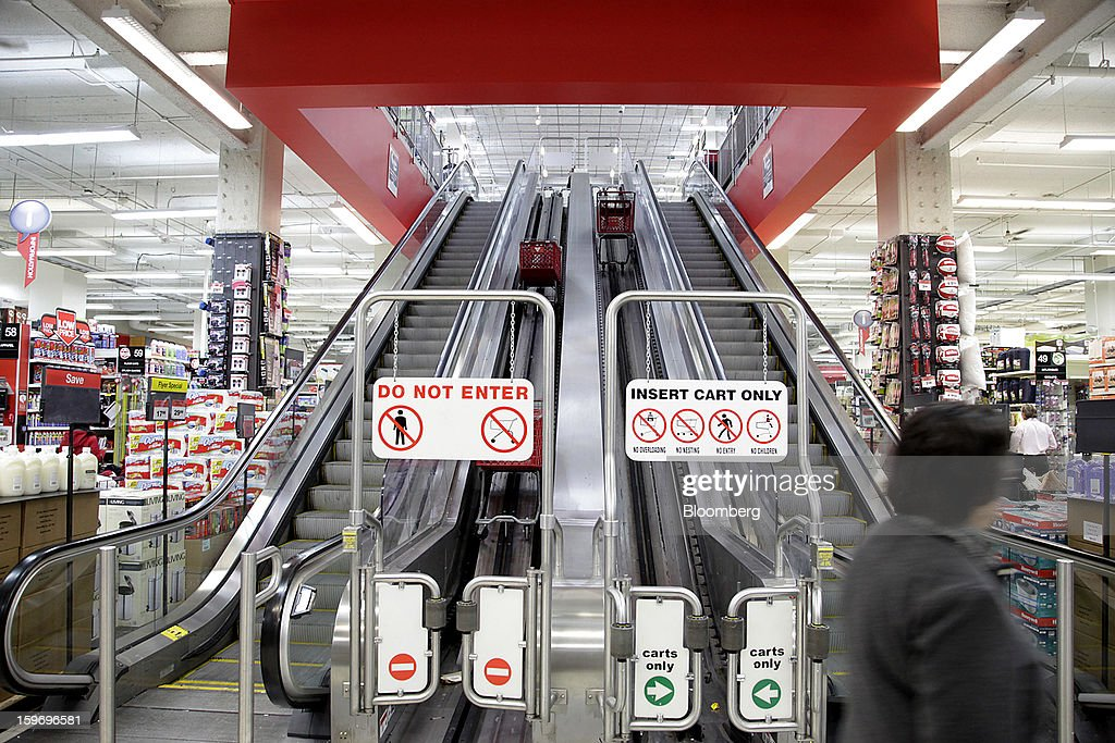 Shopping carts ride up an escalator at a Canadian Tire Corp. store in Toronto, Ontario, Canada, on Friday, Jan. 18, 2013. STCA - Statistics Canada is scheduled to release retail sales data on Jan. 21. Photographer: Reynard Li/Bloomberg via Getty Images