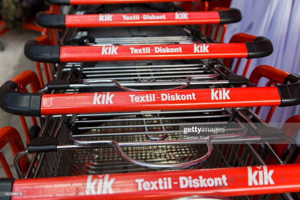 Shopping carts show the logo of the company Kik outside a Kik discount textiles store on September 18, 2012 in Berlin, Germany. Kik, a nationwide discount clothing chain in Germany, is reportedly among the companies that sourced some of its production to the garment factory in Karachi, Pakistan, that recently burned down, killing at least 258 people.