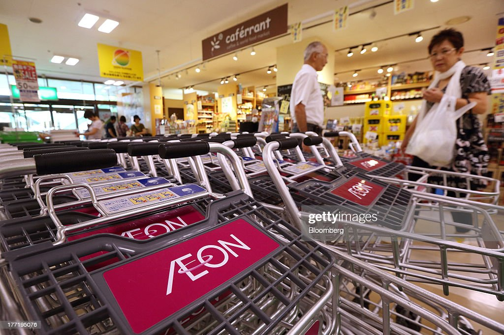 Shopping carts sit at an Aeon Co. supermarket during a sale jointly held with Daiei Inc. at an Aeon supermarket in Tokyo, Japan, on Thursday, Aug. 22, 2013. Aeon's acquisition of 48.4 million Daiei shares will take place on Aug. 27 after the completion of tender offer yesterday, according to a statement to the Tokyo Stock Exchange released today. Photographer: Tomohiro Ohsumi/Bloomberg via Getty Images