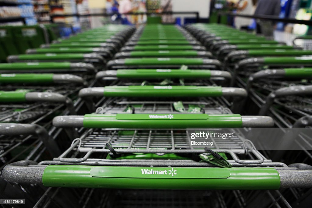 Shopping carts sit during the grand opening of a Wal-Mart Stores Inc. location in the Chinatown neighborhood of Los Angeles, California, U.S., on Thursday, Sept. 19, 2013. Wal-Mart Stores Inc. will phase out 10 chemicals it sells in favor of safer alternatives and disclose the chemicals contained in four product categories, the company announced Sept. 12. Photographer: Patrick T. Fallon/Bloomberg via Getty Images