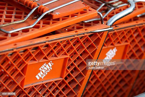 Shopping carts sit in front of a Home Depot store on November 18 2014 in Daly City California Home Depot reported a 14 percent increase in third...