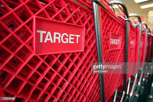 Shopping carts sit inside a Target store on May 23 2007 in Chicago Illinois Today Target Corp reported an 18 per cent increase in their firstquarter...