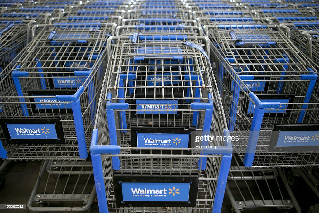 Shopping carts sit inside a Wal-Mart store in Alexandria, Virginia, U.S., on Wednesday, Nov. 14, 2012. Wal-Mart Stores Inc. is scheduled to release earnings data on Nov. 15. Photographer: Andrew Harrer/Bloomberg via Getty Images