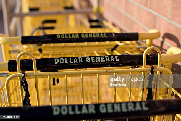 Shopping carts sit outside a Dollar General Corp store in Princeton Illinois US on Wednesday March 11 2015 Dollar General Corp is scheduled to...