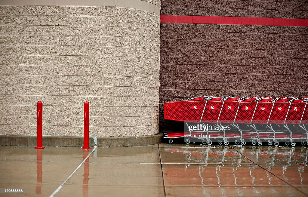 Shopping carts sit outside a Target Corp. store in Peru, Illinois, U.S., on Thursday, Feb. 7, 2013. Target Corp. led U.S. retailers to the biggest monthly same-store sales gain in more than a year as shoppers snapped up discounted merchandise chains were clearing out after the holidays. Photographer: Daniel Acker/Bloomberg via Getty Images