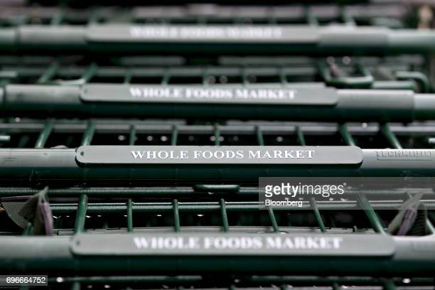 Shopping carts sit outside a Whole Foods Market Inc location in Naperville Illinois US on Friday June 16 2017 Amazoncom Inc will acquire Whole Foods...