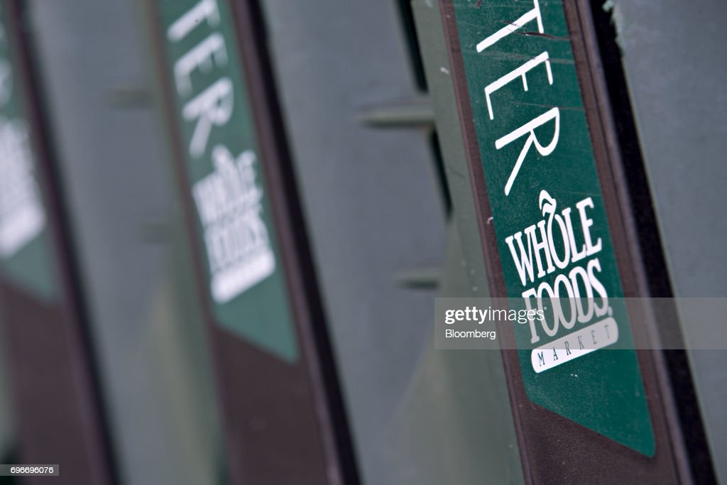 Shopping carts sit outside a Whole Foods Market Inc. location in Willowbrook, Illinois, U.S., on Friday, June 16, 2017. Amazon.com Inc. will acquire Whole Foods Market Inc. for $13.7 billion, a bombshell of a deal that catapults the e-commerce giant into hundreds of physical stores and fulfills a long-held goal of selling more groceries. Photographer: Daniel Acker/Bloomberg via Getty Images