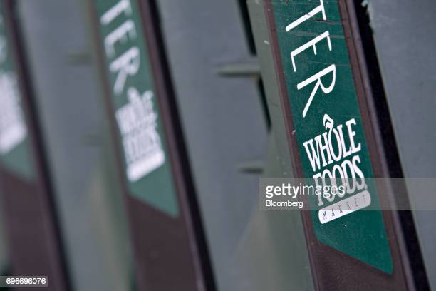 Shopping carts sit outside a Whole Foods Market Inc location in Willowbrook Illinois US on Friday June 16 2017 Amazoncom Inc will acquire Whole Foods...