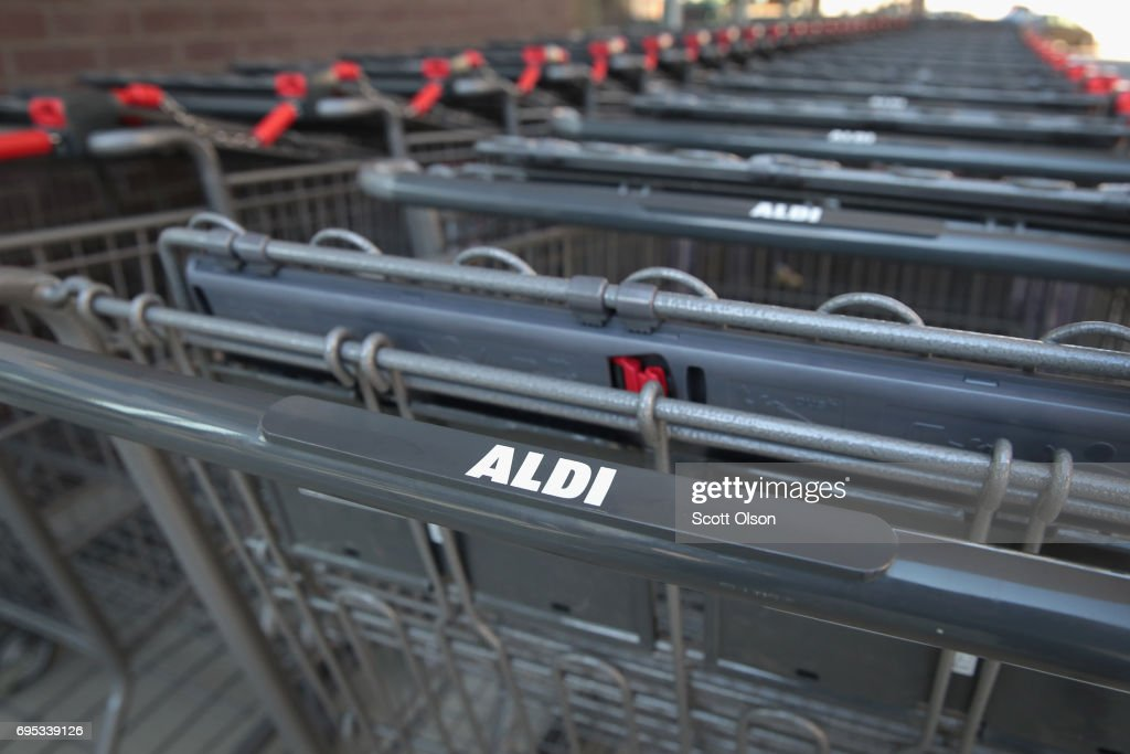Shopping carts sit outside an Aldi grocery store on June 12, 2017 in Chicago, Illinois. Aldi has announced plans to open 900 new stores in the United States in the next five years. The $3.4 billion capital investment would create 25,000 jobs and make the grocery chain the third largest in the nation behind Wal-Mart and Kroger.