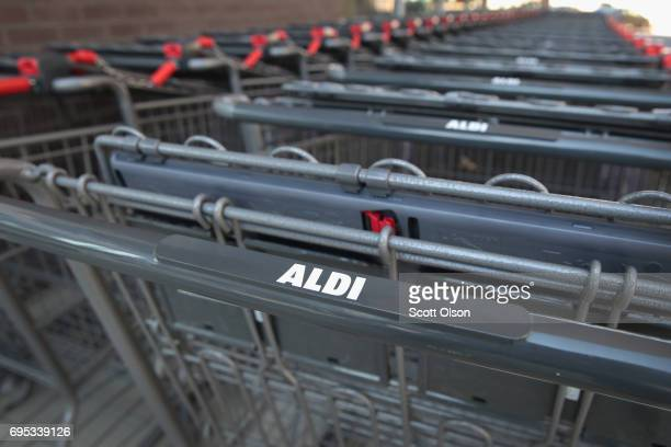Shopping carts sit outside an Aldi grocery store on June 12 2017 in Chicago Illinois Aldi has announced plans to open 900 new stores in the United...