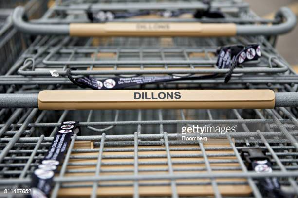Shopping carts sit outside outside of a Dillons Food Stores supermarket owned by Kroger Co in Hays Kansas US on Thursday June 29 2017 Kroger remains...