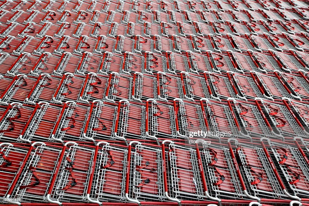 Shopping carts sit outside the entrance to a Costco store in New York US on Wednesday Nov 11 2009 The store Costco's first in Manhattan opens for...