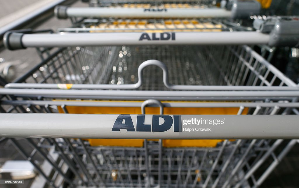 Shopping carts stand at an Aldi store on April 8, 2013 in Ruesselsheim near Frankfurt, Germany. Aldi, which today is among the world's most successful discount grocery store chains, will soon mark its 100th anniversary and traces its history back to Karl Albrecht, who began selling baked goods in Essen on April 10, 1913 and founded the Aldi name by shortening the phrase Albrecht Discount. His sons Karl Jr. and Theo expanded the chain dramatically, creating 300 stores by 1960 divided between northern and southern Germany, with Aldi Nord and Aldi Sued, respectively. Today the two chains have approximately 4,300 stores nationwide and have also expanded into other countries across Europe and the USA. Aldi Nord operates in the USA under the name Trader Joe's.
