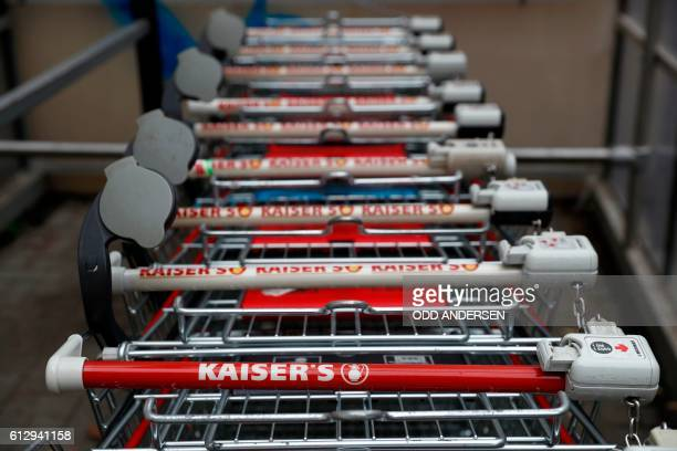 Shopping carts stand in front of a Kaiser's supermarket of the Kaiser's Tengelmann group in Berlin on October 6 2016 A high level meeting of the...