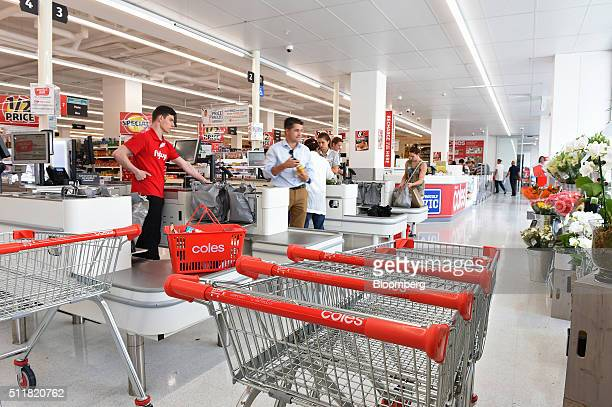 Shopping carts stand near the checkout counters in a Coles supermarket operated by Wesfarmers Ltd in Melbourne Australia on Tuesday Feb 23 2016...