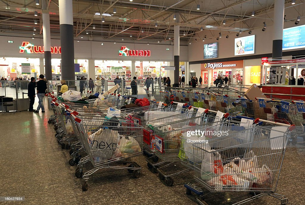 Shopping carts stand outside an Auchan Groupe SA supermarket in the MEGA Belaya Dacha shopping complex, constructed by the real estate development arm of Inter Ikea Systems BV and one of Europe's largest malls, in Moscow, Russia, on Thursday, Jan. 31, 2013. Russian shopping-mall construction may climb to a record this year as retailers take advantage of rising sales by moving into bigger, more modern buildings, Cushman & Wakefield Inc. said. Photographer: Andrey Rudakov/Bloomberg via Getty Images