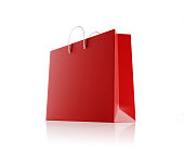 Red shopping bag isolated on white background. Horizontal composition with copy space and clipping path. Great use for shopping related concepts.
