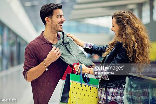 Shopping couple are laughing in the Mall