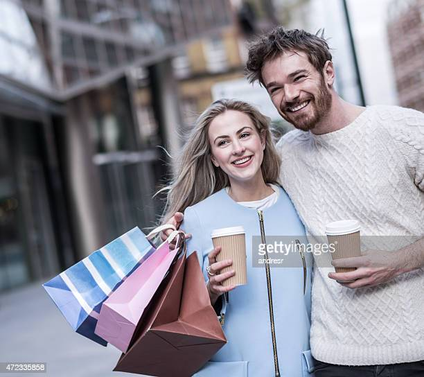 Shopping couple drinking coffee on the go