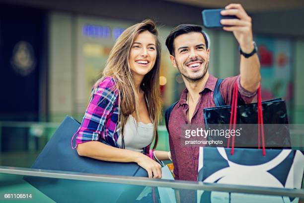 Shopping couple is taking selfie in the Mall