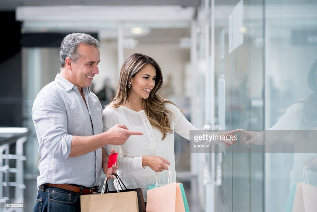 Shopping couple looking at a window
