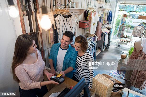 Shopping couple paying by credit card
