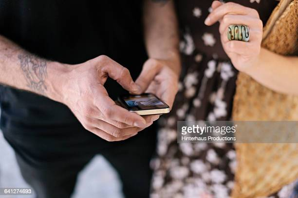 Shopping couple using Smartphone