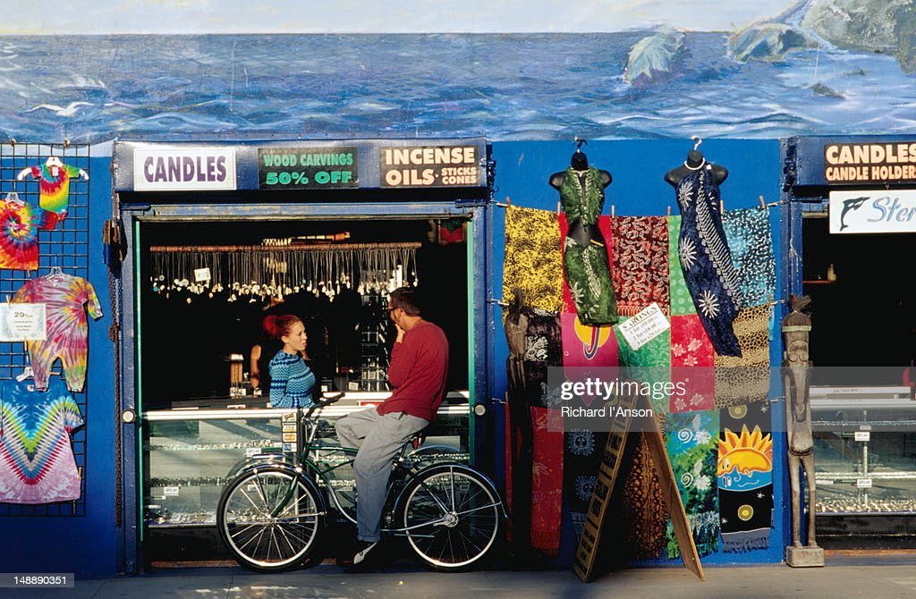 Shopping from a bicycle at Venice Boardwalk, Venice Beach. : Stock Photo