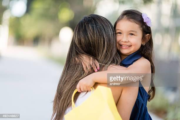 Shopping girl hugging her mother