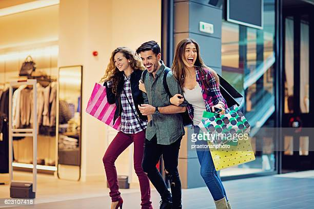 Shopping girls and man are walking in the Mall