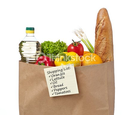 shopping list on a bag of groceries stock photo thinkstock