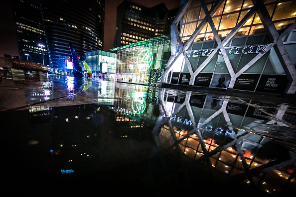 Shopping mall Les Quatre Temps and New Look shop reflecting into a puddle on February 13 2016 in Paris La Defense France