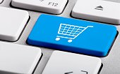 Blue Bottom with Shopping Trolley on a Laptop - Close Up