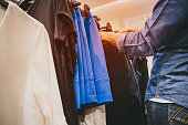 a woman choose some clothes.