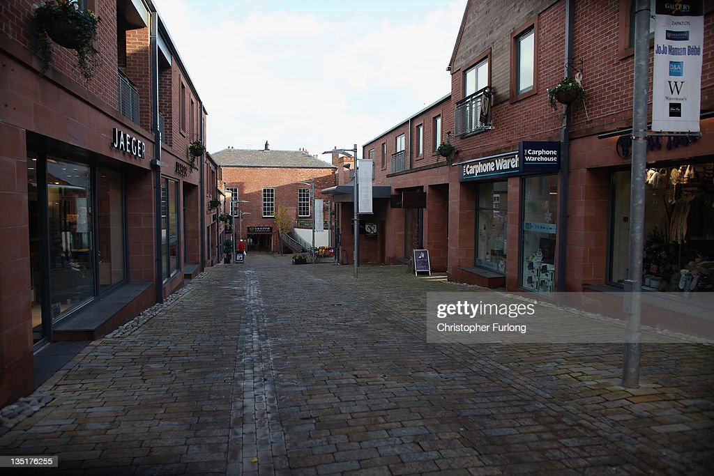 A shopping precinct in the Cheshire market town of Knutsford is empty on December 7, 2011 Knutsford, England. With a weak outlook at the start of the Christmas shopping boom, many retailers are slashing prices with the hopes of combating weak sales.