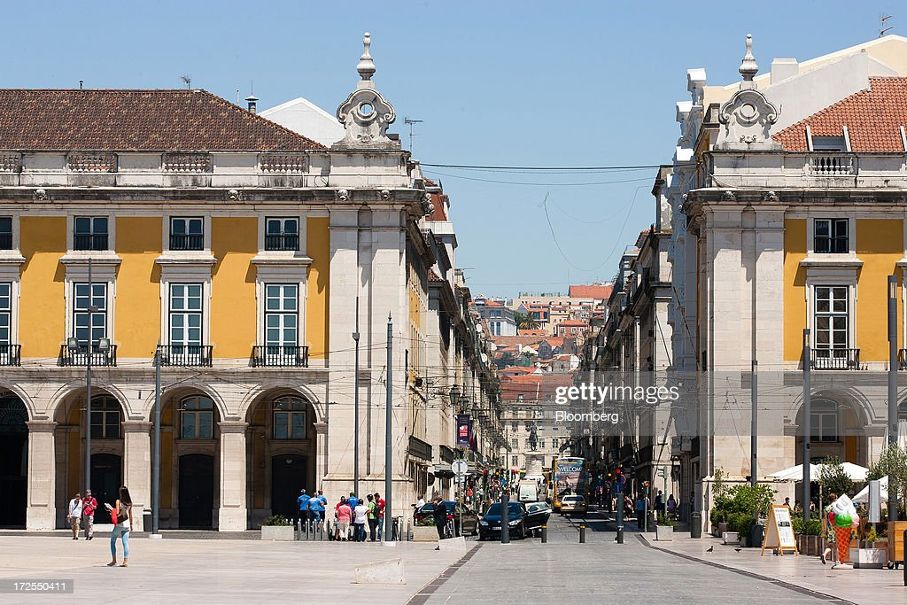 A shopping street is seen from Commercio plaza in Lisbon, Portugal, on Wednesday, July 3, 2013. Portuguese borrowing costs topped 8 percent for the first time this year after two ministers quit, signaling the government will struggle to implement further budget cuts as its bailout program enters its final 12 months. Photographer: Mario Proenca/Bloomberg via Getty Images