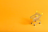Shopping theme with shopping cart on a yellow background