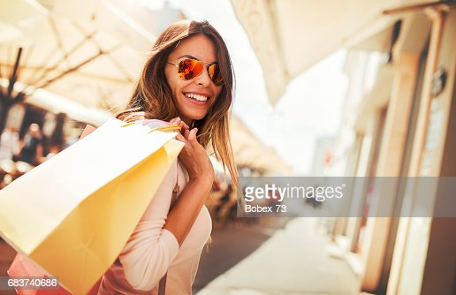 Shopping time. Young woman in shopping looking for presents. Consumerism, shopping, lifestyle concept : Stock Photo