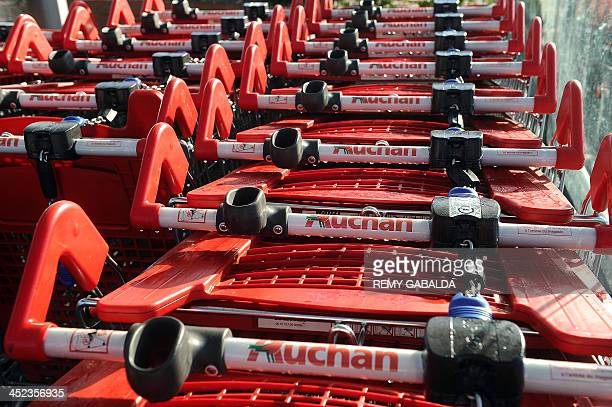 Shopping trolleys are pictured in an Auchan supermarket on November 28 2013 in Toulouse AFP PHOTO / REMY GABALDA