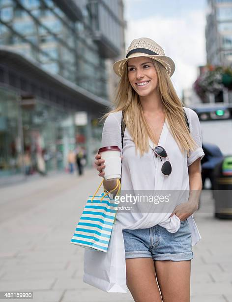 Shopping woman having a coffee on the go