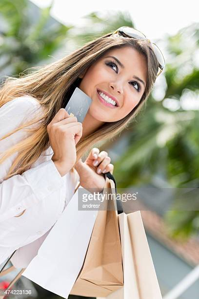 Shopping woman holding a credit card