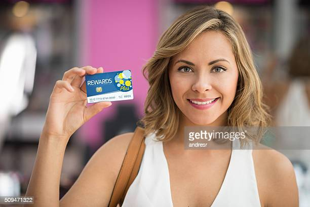 Shopping woman holding a fidelity card