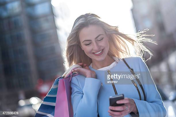Shopping woman using app on her phone
