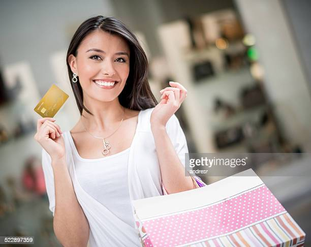 Shopping woman with a credit card